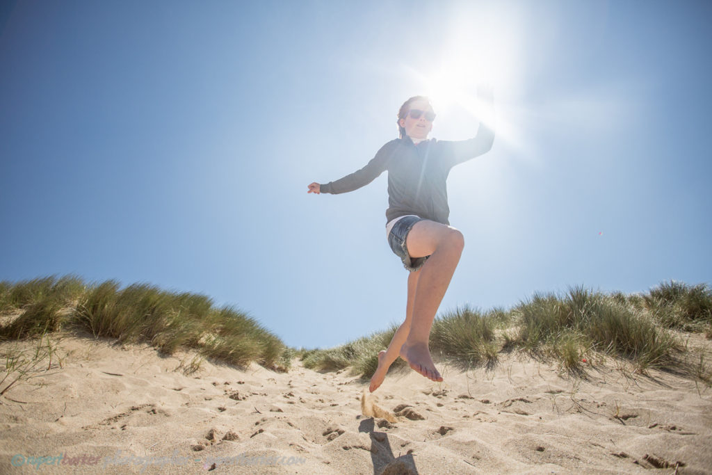 holywell sand dunes jumping girl
