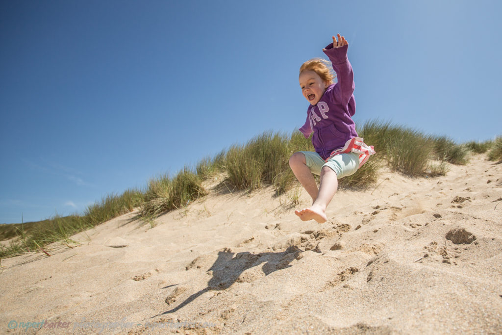 holywell sand dunes jumping girl daughter