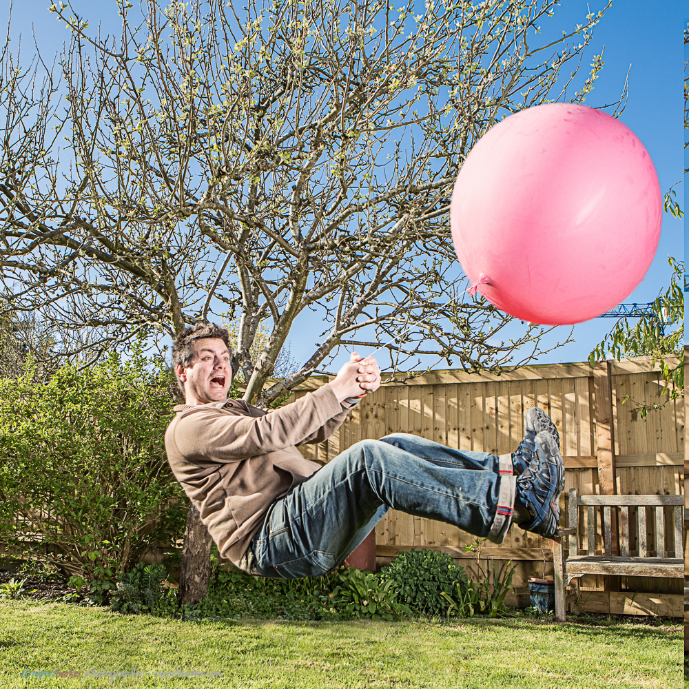 Flying balloon man pink levitation