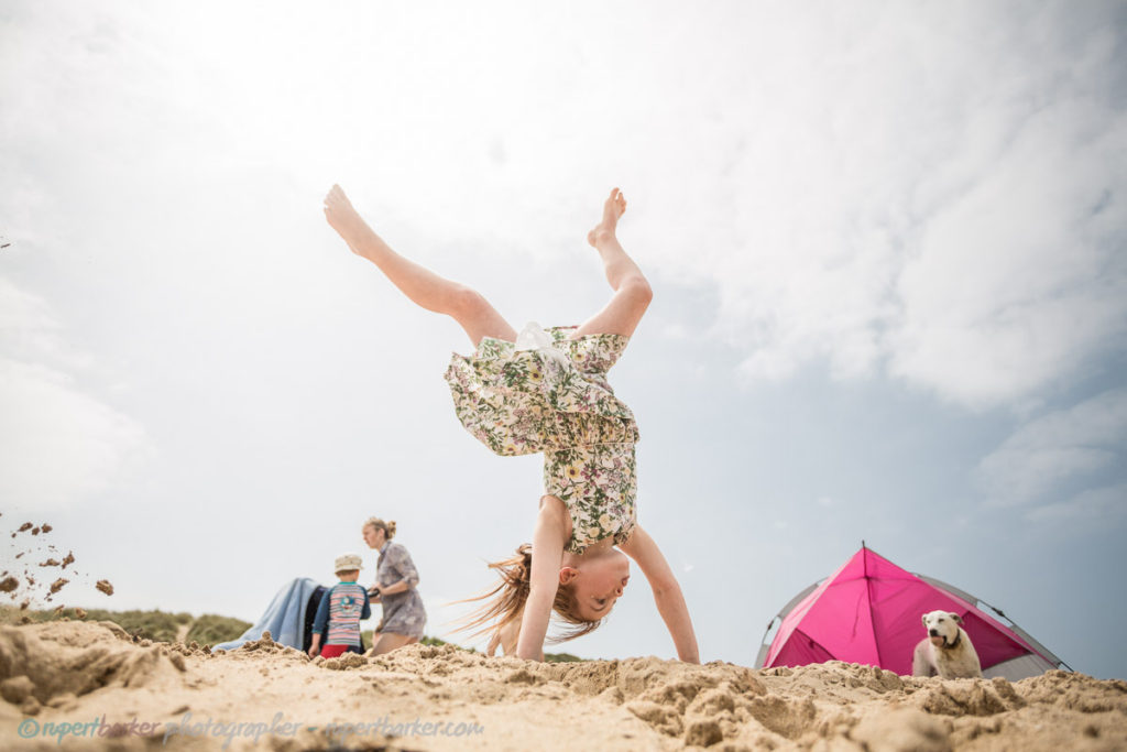 Crantock Beach cartwheels girl daughter