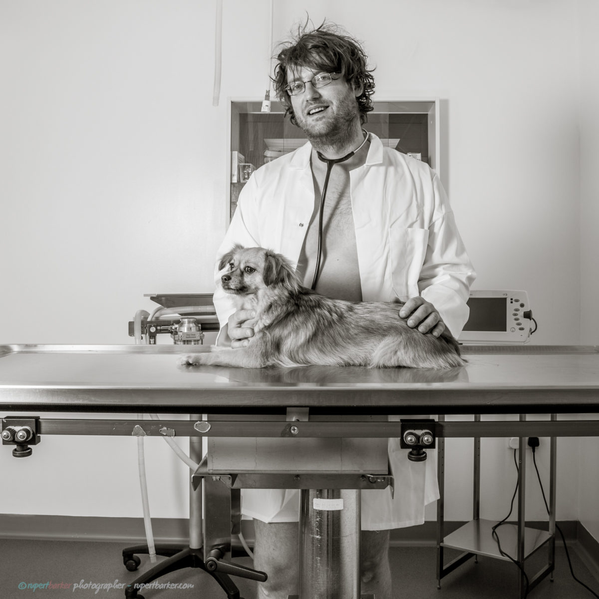 Vet naked portrait with rescue dog